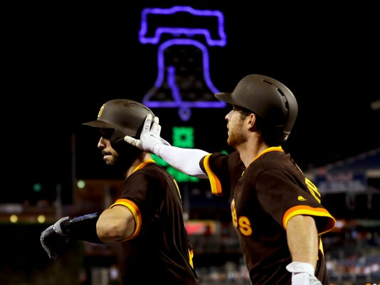 San Diego Padres' Austin Hedges, left, and Cory Spangenberg celebrate after Hedges hit a go-ahead RBI-sacrifice fly during the ninth inning of a baseball game against the Philadelphia Phillies, Friday, July 7, 2017, in Philadelphia. (AP Photo/Matt Slocum)