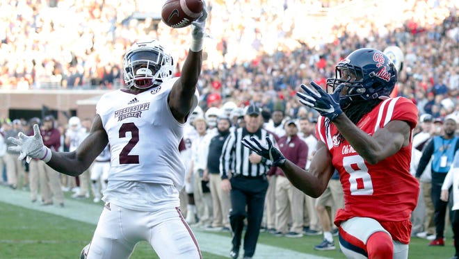Mississippi State defensive back Jamal Peters (2) reaches up and intercepts a pass intended for Mississippi wide receiver Quincy Adeboyejo (8) in the end zone in the 2016 Egg Bowl.