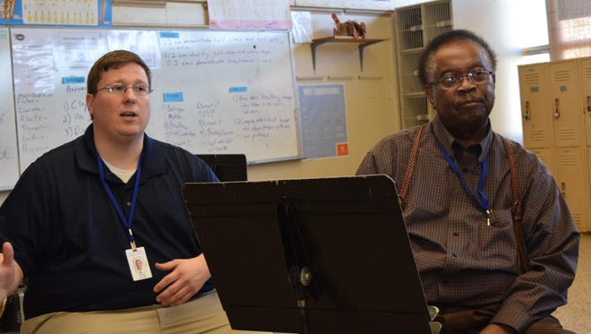Alexandria Middle Magnet School band director Steven Arnold (left) and choir teacher James Addison talk about the value of the school's performing arts programs.