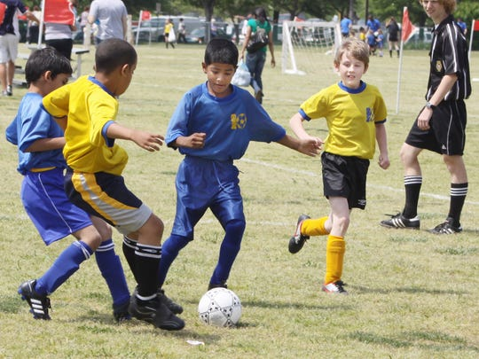 Kids face off for a Saturday of games at Heritage Park