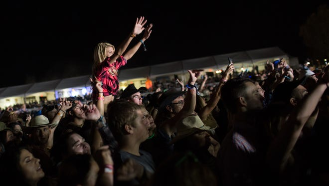 Fans dance to Florida Georgia Line in front of the main stage at Country Thunder music festival on Friday, Apr. 8, 2016 in Florence, Ariz.