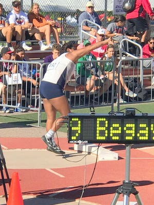 Silver's Aysia Salas tosses the shot put at the Class 4A New Mexico High School State Track and Field Championships. She threw over 40 feet to capture the gold.