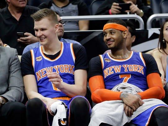 Knicks' Kristaps Porzingis, left, and Carmelo Anthony