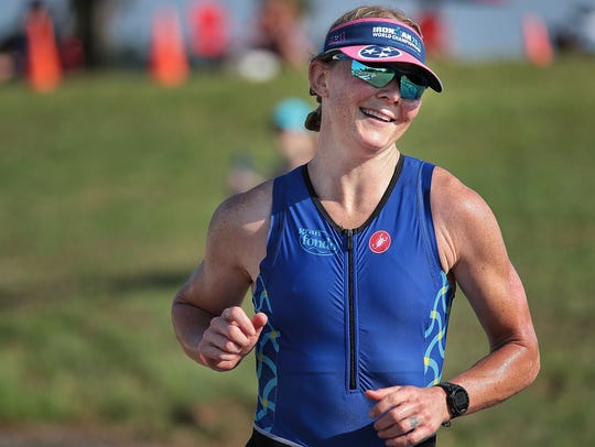 Women's winner Kirsten Sass starts the final running leg of the 36th annual Memphis In May Olympic Triathlon on Sunday at Edmund Orgill Park in Millington.