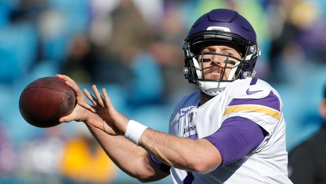 Minnesota Vikings' Case Keenum (7) warms up before an NFL football game against the Carolina Panthers in Charlotte, N.C., Sunday, Dec. 10, 2017.