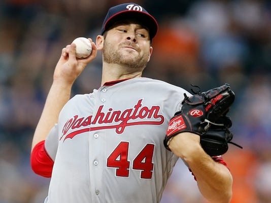 Washington Nationals starting pitcher Lucas Giolito (44) delivers during the first inning of a baseball game Thursday, July 7, 2016, in New York. (AP Photo/Kathy Willens)
