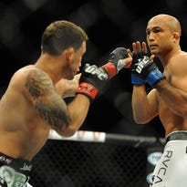 Frankie Edgar, left, attacks BJ Penn during their TUF finale in July. Penn lost and retired after their fight, taking some of Edgar's limelight.