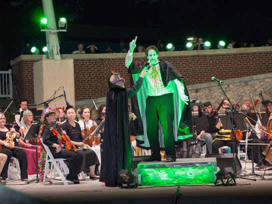 Conductor Darko Butorac, in the cape, gets into the spirit of the evening during the inaugural Spooktacular concert by the TSO. The concert is back on Friday night in Cascades Park.