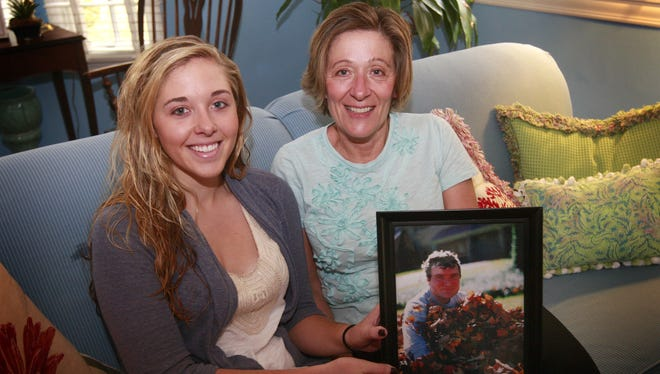Nancy Eigel-Miller, pictured at right in this 2010 Enquirer photograph with her daughter Elizabeth Miller,  lost her husband Jim Miller when he took his own life in July 2008. Eigel-Miller was named the 2018 Jefferson Award winner on March 1, 2017, for her efforts normalizing mental health issues, particularly those affecting young people.