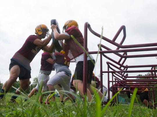 Central Regional lineman drill during morning practice. Central Regional Football gets ready for 2017 Season Opener. Berkeley, NJ. on August 23, 2017.