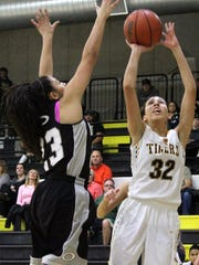 Jackie Hanson, right, puts up a shot while being guarded by Kiyana Williams.