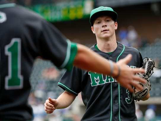 Mason's Will Pfennig (3) returns to the dugout in the