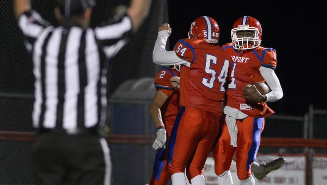 Fairport's Keshawn Howard, right, celebrates a touchdown run with teammate Mitch Disanto during the regular season.