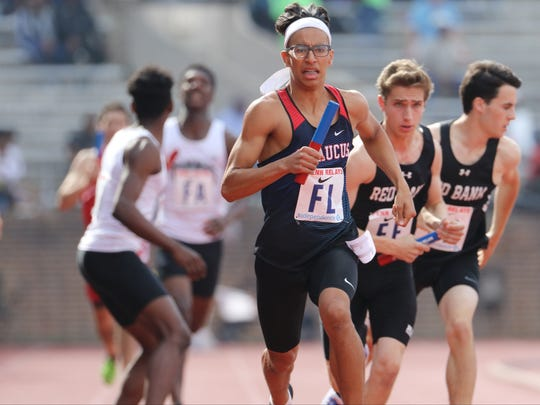 Adam Khriss of Secaucus gets ready to run a 49.64 400 in the 4x400 meters at the Penn Relays. It was the fastest anchor leg in the heat by more than a second.  Saturday, April 29, 2017.