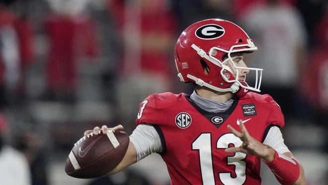 Georgia quarterback Stetson Bennett looks for a receiver during the second half of the team's NCAA college football game against Auburn, Saturday, Oct. 3, 2020, in Athens, Ga.