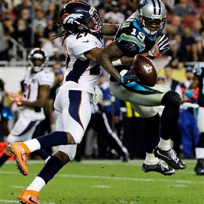 Denver Broncos' Bradley Roby, left, breaks up a pass