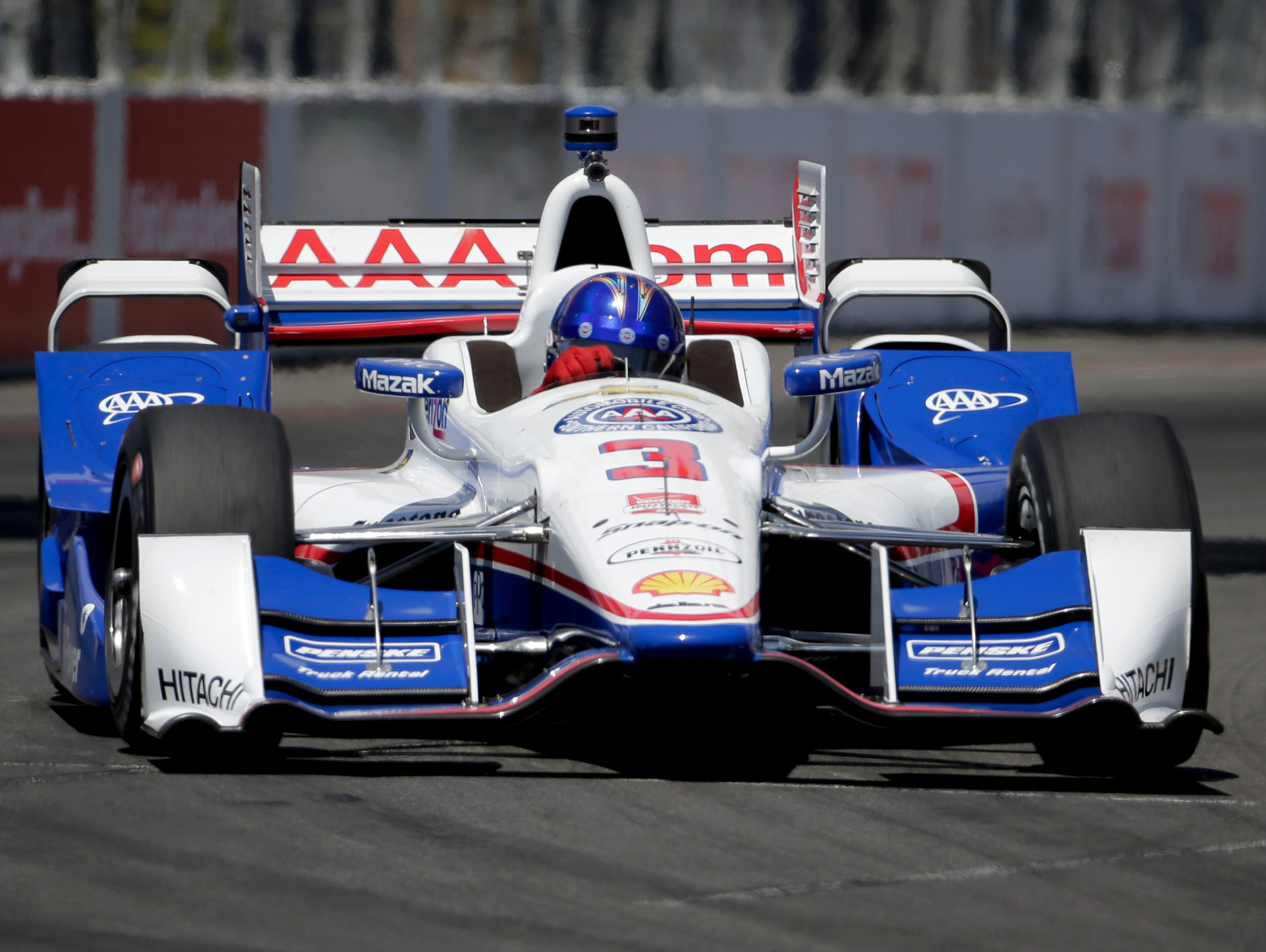 Helio Castroneves drives during a practice run for the IndyCar race at the Toyota Grand Prix of Long Beach on Friday, April 17, 2015 in Long Beach, Calif.