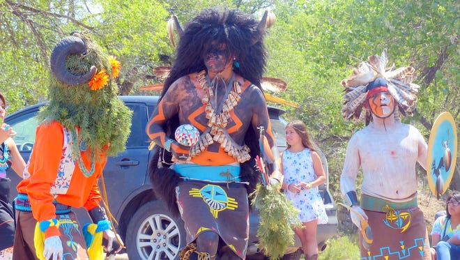Dancers in a previous Mescalero parade added spirit and color.