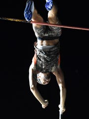 """MIKE LAWRENCE / THE GLEANERPro-elite pole vaulter Sean Young clears 17' 3"""" during Friday's Jammin' and Jumping Street vault held at the Henderson riverfront, August 12, 2016."""