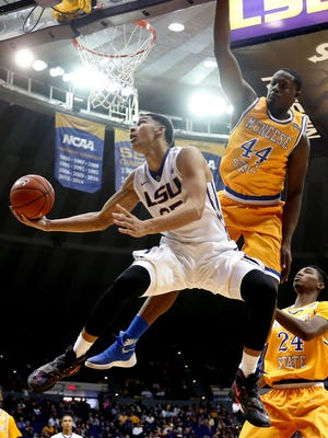 LSU forward Ben Simmons (25) goes to the basket against McNeese State forward Austin Lewis (44) in the second half of an NCAA college basketball game in Baton Rouge, La.