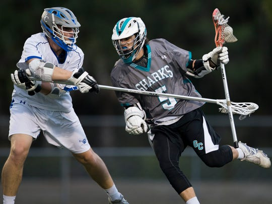 Barron Collier and Gulf Coast boy's lacrosse faceoff during the first half of a first-round play-in game at Barron Collier High School Thursday, April 13, 2017 in Naples. Barron Collier led 5-4 at the half.