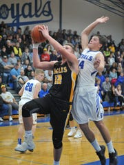 Colonel Crawford's Gavin Feichtner goes up for a layup with Wynford's Cole Heinlen defending him.