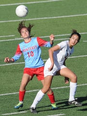 Lubbock Monterey's Daniela Perez, left, and Cooper's Hayden Abor eye the ball during their District 4-5A game Tuesday, March 20, 2018 at Shotwell Stadium. Monterey won 3-1.