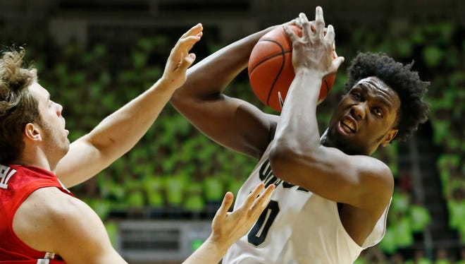 Caleb Swanigan pulls down a rebound in front of Mickey Mitchell of Ohio State Thursday, January 21, 2016, at Mackey Arena. Purdue defeated Ohio State 75-64.
