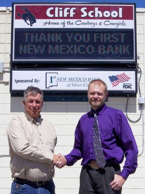Cliff School received a new digital marquee, thanks to a donation from First New Mexico Bank. A.D.Richins Jr., assistant vice president for First New Mexico Bank, left, and Principal Dean Spurgeon stand in front of the new marquee, which was installed by Jubal Williamson of WSI Southwest.