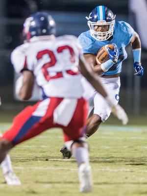 Ascension Episcopal running back Jhalen Brown with the ball and the first down Thursday Sept. 14, 2017.