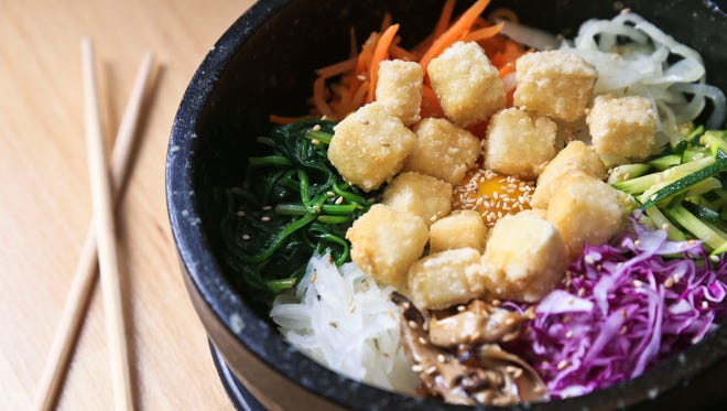 The Dolsot Bibimbap features rice with vegetables such as carrot, radish and cabbage with a fresh-fried egg for $10.95 from Kim&Bab in New Albany.