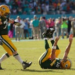 Green Bay Packers quarterback Aaron Rodgers reacts after throwing the game winning-touchdown in the closing seconds during the Week 6 game against the Miami Dolphins at Sun Life Stadium.