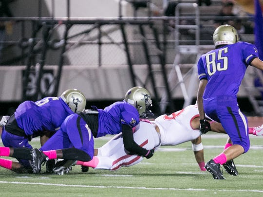 Miller linebacker Justice Watson (80) brings down W.B. Ray Texan Joshua Alvarez (9) and forces a fumble on Friday, October 21st at Buc Stadium in Corpus Christi.