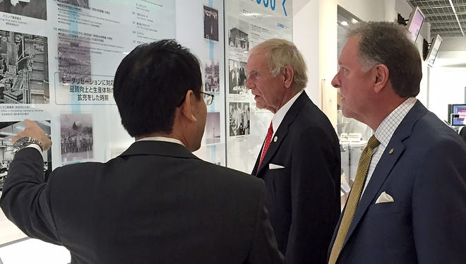 Jackson Mayor Jerry Gist, middle, and Madison County Mayor Jimmy Harris, right, visit with Denso executives at their corporate offices in Japan. Denso is the parent company of TBDN Tennessee Company.