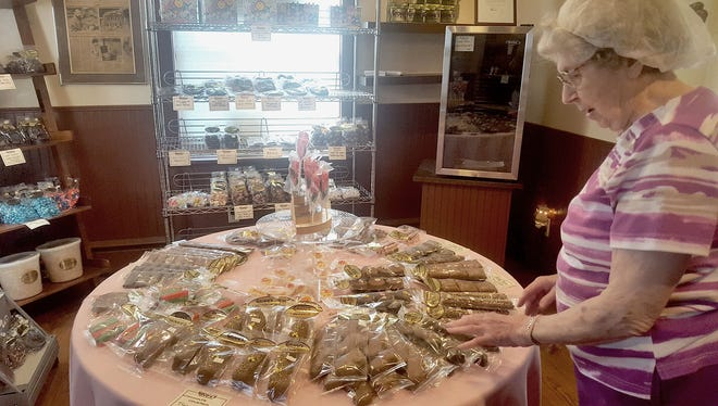 At Grove's Brittle Works, 1424 E. Chocolate Ave., Hershey, Mildred Grove shows the various types of brittles and candies. The store is celebrating its 60th anniversary this year.
