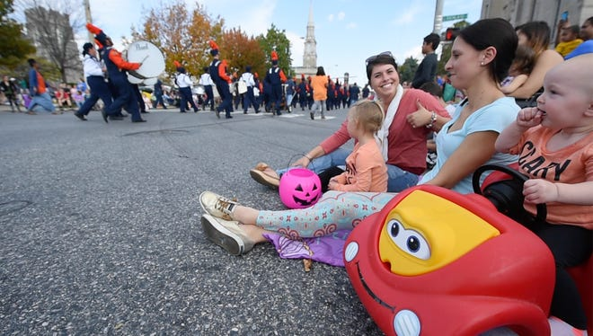 From the left Marissa James, with Veronica Althoff, Tamara Althoff and Blare, age 1, watch the the York Halloween Parade October 30, 2016 from West Market Street in York.