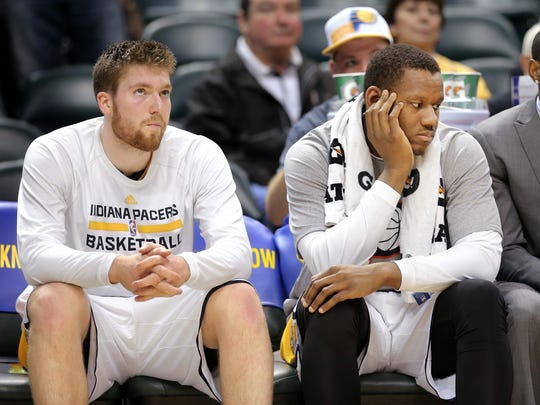 Pacers players Shayne Whittington, left, and Lavoy Allen can only watch as the Pacers lose another game in the final minute of the game held at Bankers Life Fieldhouse on Saturday, Nov. 8, 2014.