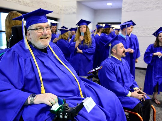 Jim Beckley of Tiffin graduates with his sixth degree from Terra State Community College.