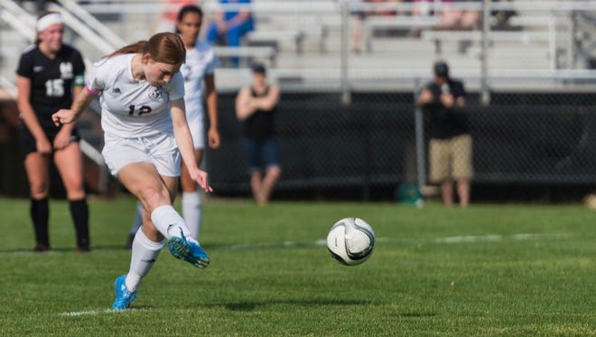 Anne Major of Okemos scores the first goal in the Chiefs' Gold Cup opening round game with Holt on a penalty kick in the first half Tuesday May 16, 2017, in Okemos.