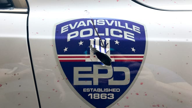 One of 23 bullet holes seen on an Evansville Police Dept. patrol car that took damage during an active shooter situation on May 11. Gunfire ripped through the Four Freedoms Monument graphic on the EPD logo.