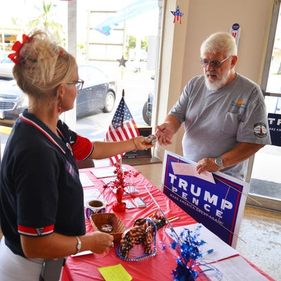 Jeff White of Cape Canaveral stops by a Donald Trump