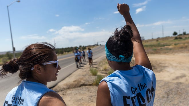 Andreanne Catt, left, and Lauren Howland prepare to join a group of runners Monday in Farmington.