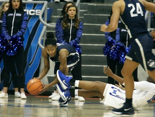 Connecticut guard Crystal Dangerfield (5) grabs a loose ball from Memphis Taylor Barnes (15) in the second half of an NCAA college basketball game Wednesday, Jan. 24, 2018, in Memphis, Tenn. (AP Photo/Karen Pulfer Focht)