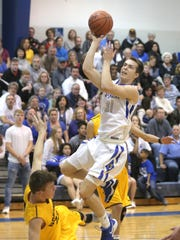 St. Peter's Jared Jakubick makes a jump shot in front of Northmor's Lane Bachelder on Saturday.