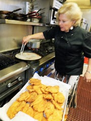 Chef Pat Bender cooks up some chicken cutlets at Dino's