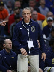 Clarkston coach Dan Fife roams the bench during Saturday's title win.