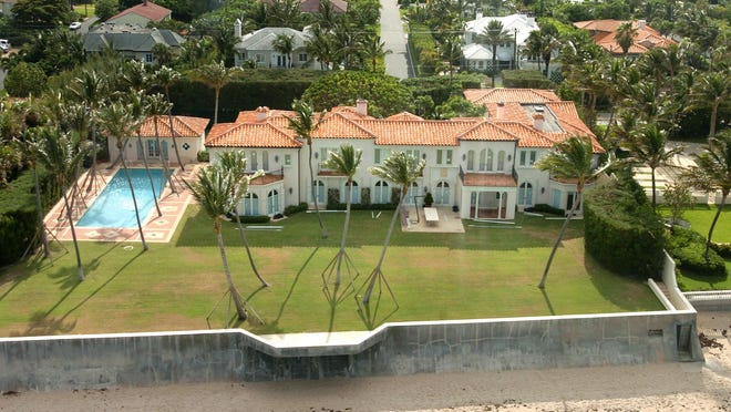 "Just sold to a trust for a recorded $70 million, the former Kennedy family estate in Palm Beach is seen in a photograph taken before the property at 1095 N. Ocean Blvd. was purchased in 2015 by a company controlled by New York real estate asset manager Jane Goldman. Goldman extensively renovated the estate,  which is known worldwide as President John F. Kennedy's ""winter White House."""
