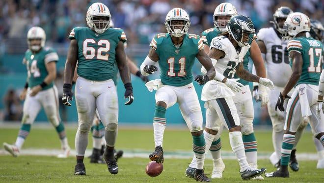 Miami Dolphins wide receiver DeVante Parker celebrates a first down on a fourth down pass completion in the fourth quarter.