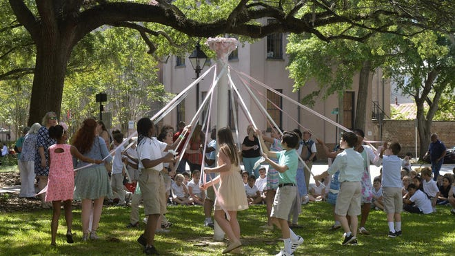 Heard Elementary School students unwrap the May Pole during the last dance at the May Day at Massie Heritage Center. Emma Adler, who died July 12, was instrumental in turning the old school into a museum.