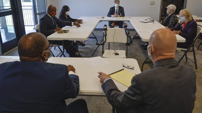 The Chatham County Board of Elections members meet on Oct. 27 to hear the appeal by Tony Riley (foreground, left) on their vote to disqualify his District 2 candidacy.